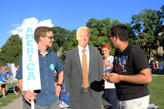 Third-year Vice President of Ohio State College Democrats Levi Griffith (left) stands with other club members and a Joe Biden standee at the Involvement Fair on Aug. 21. Credit: Alexa Mavrogianis | Photo Editor