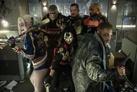 The main cast members of Suicide Squad include Margot Robbie (Harley Quinn), from left, Adewale Akinnuoye-Agbaje (Killer Croc), Karen Fukuhara (Kitana), Joel Kinnaman (Rick Flag), Jai Courtney (Captain Boomerang) and Will Smith (Deadshot). Credit: Courtesy of TNS