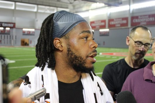 Cam Burrows talks to the media on Aug. 12 after practice at the Woddy Hayes Athletic Center. Credit: Jacob Myers | Assistant Photo Editor