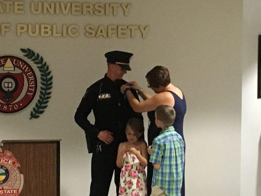 Family members help pin Lt. Brandon Yankanin's new badge during a ceremony held on Aug. 26. Credit: Dan Smyth | Lantern Reporter