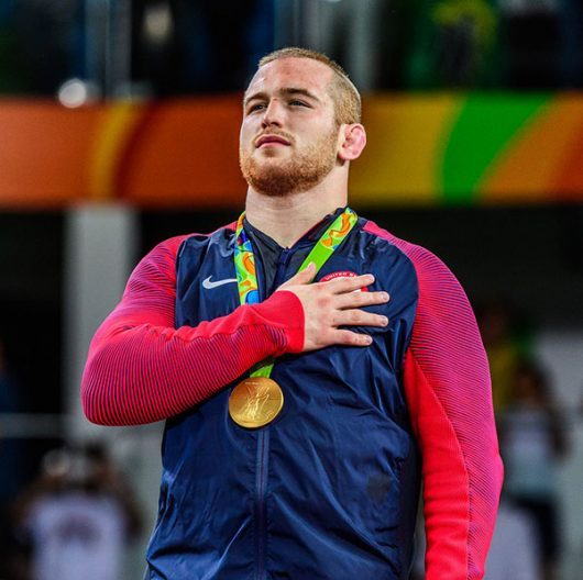 OSU junior Kyle Snyder stands at attention for the U.S. national anthem after receiving his gold medal on Aug. 21. Credit: Courtesy of Tony Rotundo