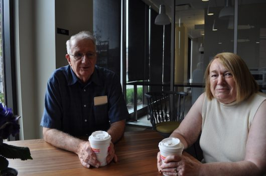 Charles and Joyce Busch sit over coffee in the lounge of Busch House residence hall, named after Charle's brother, Jon. Credit: Nick Roll | Campus Editor