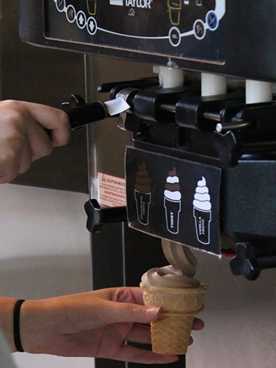 A student uses the ice cream machine inside of Traditions at Scott. Credit: Mason Swires | Assistant Photo Editor