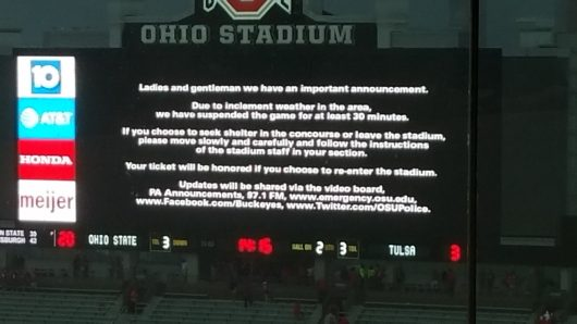 A message on the Ohio Stadium video board issuing a delay due to inclement weather. Credit: Nick McWilliams | Sports Editor