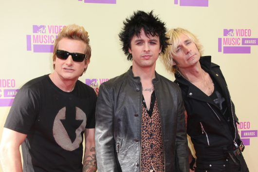 (L-R) Musicians Tre Cool, Billie Joe Armstrong and Mike Dirnt of Green Day arrive at the 2012 'MTV Video Music Awards' in Los Angeles in 2012. Credit: Courtesy of TNS