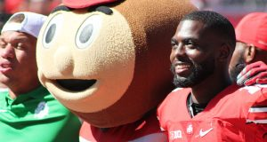 Brutus and a smiling J.T. Barrett lock arms to sing Carmen Ohio after the first game of the 2016 season against Bowling Green on Sept. 3 at Ohio Stadium. The Buckeyes _ 77-10. Credit: Mason Swires | Assistant Photo Editor