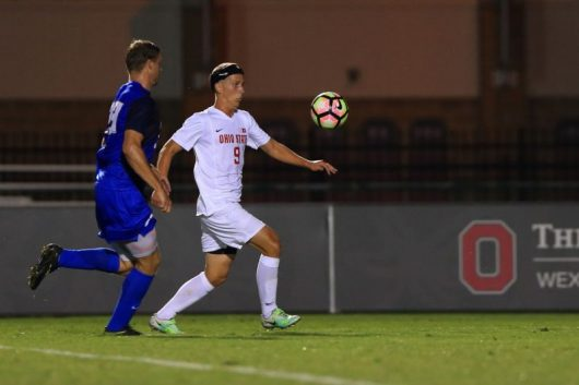 Senior forward Danny Jensen advances the ball down the field against a UC Santa Barbara defender. Credit: Ohio State Athletics