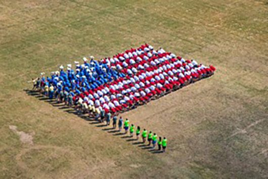 Campers make a flag to celebrate Team USA for the Summer Olympics. Credit: Courtesy of Theresa Ferrari