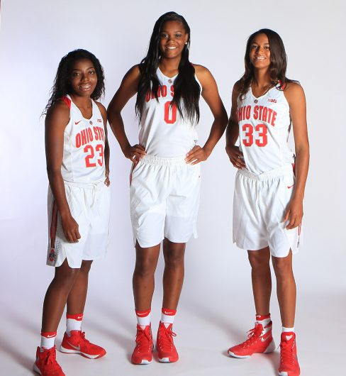 Freshman Kiara Lewis (23), Tori McCoy (0) and Jensen Caretti (33) pose for a photo together donning their Ohio state uniforms. Credit: Courtesy of Ohio State Athletics