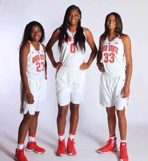 Freshman Kiara Lewis (23), Tori McCoy (0) and Jensen Caretti (33) pose for a photo together donning their Ohio state uniforms. Credit: Courtesy of Ohio State Athletics