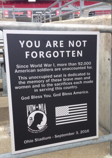 """A sign reading """"YOU ARE NOT FORGOTTEN"""" in front of the POW-MIA seat at Ohio Stadium. Credit: @OhioStAthletics"""