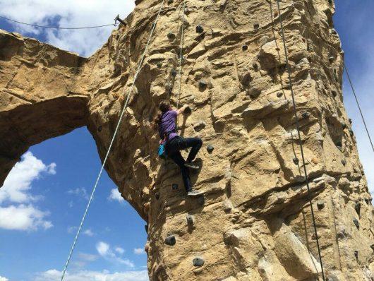 Elizabeth Heym, a third-year in computer science engineering, climbs a rock wall. Credit: Courtesy of Alex Leeder
