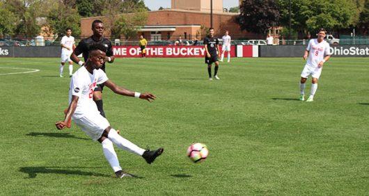 Ohio State sophomore forward Mohamed Abdi passes the ball upfield against Rutgers on Sept. 18, 2016. Credit: Gene Ross | For The Lantern