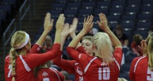 Members of the Ohio State women's volleyball team celebrate after scoring against LIU Brooklyn on Sept. 2, 2016. OSU won, 3-0. Credit: Jenna Leinasars | Multimedia Editor