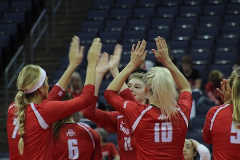 Members of the Ohio State women's volleyball team celebrate after scoring against LIU Brooklyn on Sept. 2, 2016. OSU won, 3-0. Credit: Jenna Leinasars   Multimedia Editor