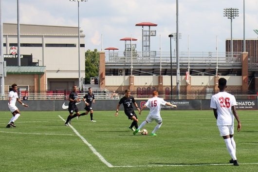 Sophomore defender Alex Nichols (15) advances the ball against Rutgers on Sept. 18. OSU won 3-1. Credit: Janaya Greene | Lantern photographer