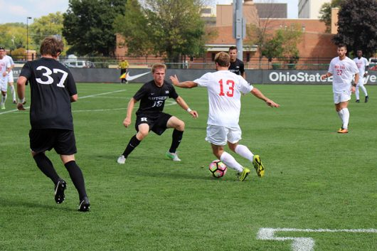 Ohio State senior forward Christian Soldat pushes the ball up the field against Rutgers in a game at Jesse Owens Memorial Stadium on Sept. 18, 2016. Credit: Gene Ross | Lantern Photographer
