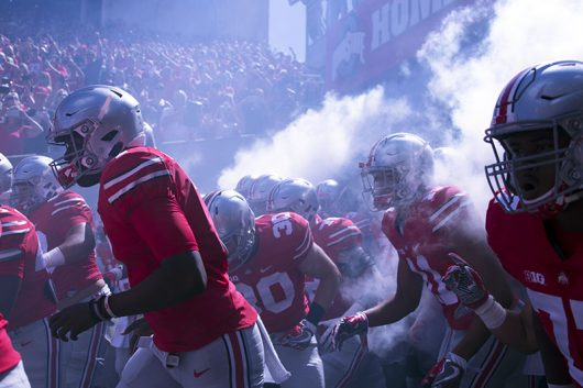 The Ohio State football team prepares to run onto the field prior to the first game of the 2016 season against Bowling Green on Sept. 3 at Ohio Stadium. The Buckeyes won 77-10. Credit: Alexa Mavrogianis | Photo Editor