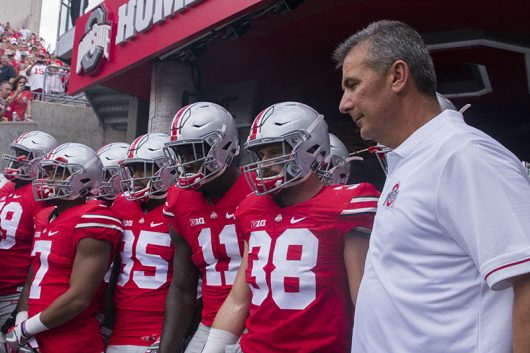 Ohio State coach Urban Meyer and the Buckeyes wait by the tunnel before the start of OSU's game against Tulsa on Sept. 10. Credit: Alexa Mavrogianis | Photo Editor