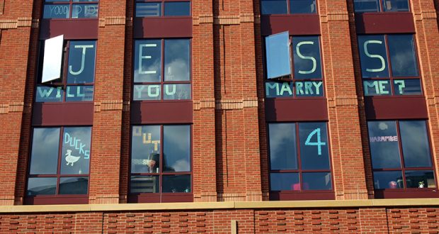 """Students in Scott House post """"Jess, Will You Marry Me?"""" and """"Ducks 4 for Harambe"""" on their windows. Credit: Dominique Johnson 
