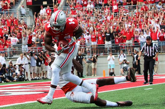 OSU redshirt freshman K.J. Hill (14)  runs into the endzone for a touchdown during the first half of the Buckeyes' season opener against Bowling Green on Sept. 3 at Ohio Stadium. The Buckeyes won 77-10. Credit: Alexa Mavrogianis | Photo Editor