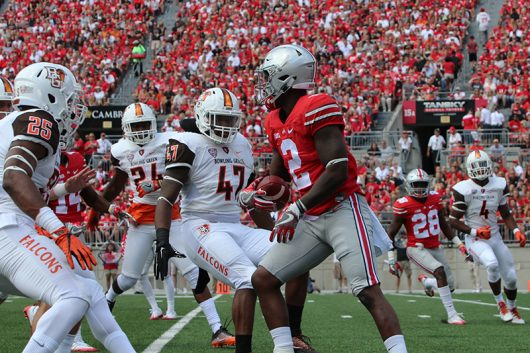 Bowling Green players surround OSU senior wide receiver Dontre Wilson (2) after a fair catch during the first half of the Buckeyes' season opener against Bowling Green on Sept. 3 at Ohio Stadium. The Buckeyes won 77-10. Credit: Alexa Mavrogianis | Photo Editor