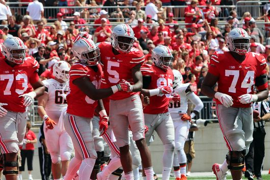 OSU sophomore wide receiver Noah Brown (80) celebrates his first half touchdown with OSU fifth-year wide receiver Corey Smith (5) during the first game of the 2016 season against Bowling Green on Sept. 3 at Ohio Stadium. The Buckeyes won 77-10. Credit: Alexa Mavrogianis | Photo Editor