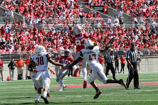 OSU sophomore wide receiver Terry McLaurin (83) makes a jumping catch during the second half of the Buckeyes' season opener on Sept. 3 at Ohio Stadium. The Buckeyes won 77-10. Credit: Alexa Mavrogianis   Photo Editor