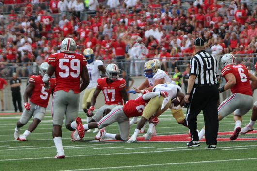 OSU redshirt junior defensive linesman Tyquan Lewis (59) rushes towards the ball carrier along with the rest of the Buckeyes defense during a game against the Tulsa Hurricane on Sept.10. The Buckeyes won 48-3. Credit: Alexa Mavrogianis | Photo Editor