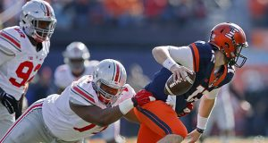 Ohio State defensive lineman Michael Hill (77) brings down Illinois quarterback Wes Lunt (12) in the first half at Memorial Stadium in Champaign, Ill., on Saturday, Nov. 14, 2015. Ohio State won, 28-3. (Kyle Robertson/Columbus Dispatch/TNS)