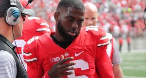 OSU redshirt junior quarterback J.T. Barrett talks to his fellow players on the bench during the first game of the 2016 season against Bowling Green on Sept. 3 in Ohio Stadium. The Buckeyes won 77-10. Credit: Mason Swires | Assistant Photo Editor