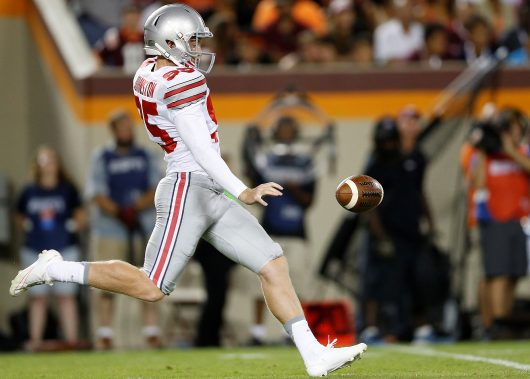 OSU then junior punter Cam Johnston punts the ball during a game against Virginia Tech on Sept. 7, 2015. Credit: Courtesy of OSU Athletics