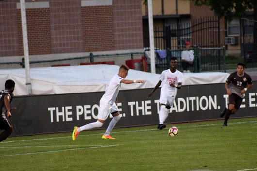 OSU junior defender Niall Logue (5) prepares to kick the ball while OSU sophomore midfielder Abdi Mohamed (26) follows during the Buckcyes game against Valparaiso on Sept. 21 at the Jesse Ownes Memorial Stadium. The Buckeyes won 4-1. Credit: Janaya Greene | Lantern Photographer