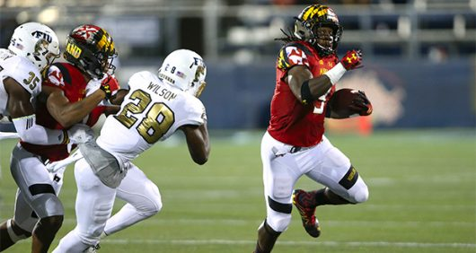 Maryland senior running back Trey Edmunds (9) carries the ball ahead of FIU safety Deonte Wilson in the third quarter on Friday, Sept. 9. at FIU Stadium in Miami. Courtesy of TNS