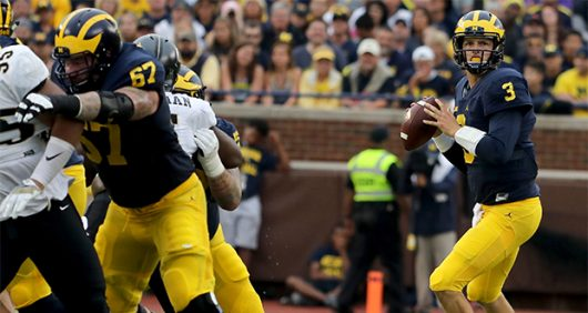 Michigan quarterback Wilson Speight (3) looks downfield for an open receiver during first-half action against Central Florida at Michigan Stadium in Ann Arbor, Mich., on Saturday, Sept. 10, 2016. Michigan won, 51-14. (Eric Seals/Detroit Free Press/TNS)