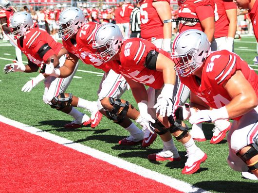 The Buckeye offensive linemen run practice drills before the first game of the 2016 season against Bowling Green on Sept. 3 at Ohio Stadium. The Buckeyes _ 77-10. Credit: Mason Swires | Assistant Photo Editor