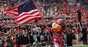 Brutus waves the American Flag after an Ohio State touchdown during the first game of the 2016 season against Bowling Green on Sept. 3 in Ohio Stadium. The Buckeyes won 77-10. Credit: Mason Swires | Assistant Photo Editor