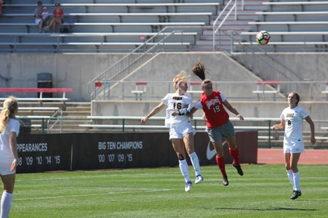 Ohio State junior forward Sammy Edwards (19) and Iowa redshirt junior defender Rachele Armand (16) leap for a header during a game at Jesse Owens Memorial Stadium on Sept. 25, 2016. The Buckeyes won the game, beating the Hawkeyes 3-0. Credit: Colin Hass-Hill | Assistant Sports Director