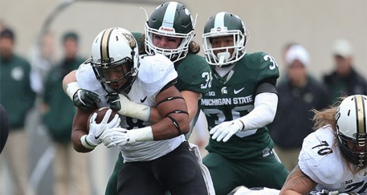 Purdue then-freshman running back Markell Jones (28) runs the ball during the first half on Satutday, Oct. 3, 2015, at Spartan Stadium in East Lansing, Mich. The host Spartans won, 24-21. Courtesy of TNS
