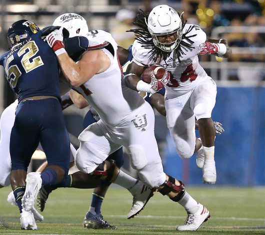 Indiana junior running back Devine Redding (34) runs in the first quarter against Florida International at Ocean Bank Field at FIU Stadium in Miami on Sept. 1. Indiana won, 34-13. Courtesy of TNS