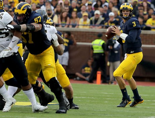Michigan junior quarterback Wilton Speight (3) looks downfield for an open receiver during first-half action against Central Florida at Michigan Stadium in Ann Arbor, Mich., on Saturday, Sept. 10. Courtesy of TNS