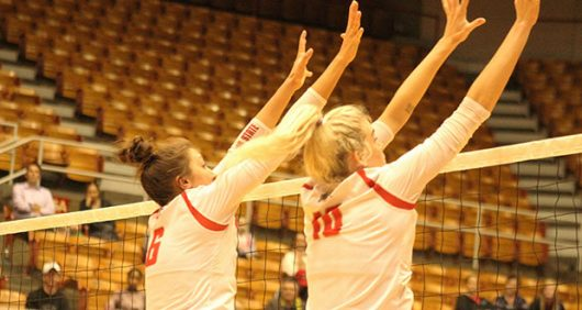 Sophomore setter Taylor Hughes (left) and senior middle blocker Taylor Sandbothe (right) block an attack from Northwestern on Sept. 28, 2016, at St. John Arena. Credit: Jenna Leinasars | Assistant News Director