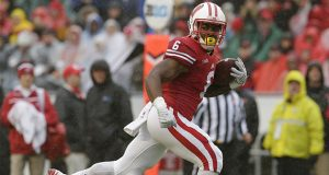 Wisconsin then-junior running back Corey Clement carries the ball en route to a 21-yard for touchdown during the second quarter against Rutgers on Saturday, Oct. 31, 2015, at Camp Randall Stadium in Madison, Wis. The host Badgers won, 48-10. Courtesy of TNS
