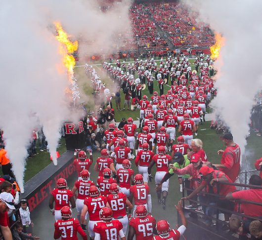 The Rutgers Scarlet Knights make their entrance before an NCAA football game against the Iowa Hawkeyes on Sept. 24 at High Point Solutions Stadium. Credit: Courtesy of TNS
