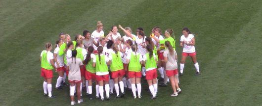 OSU women's soccer team huddles during a game against Texas on Sept. 9, 2016. OSU won, 2-1. Credit: James King | Lantern Reporter