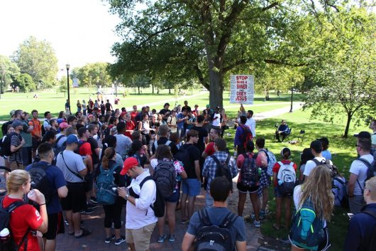Students gather on The Oval around preachers affiliated with Militant Christian Media. Credit: Tim Hayes   For The Lantern