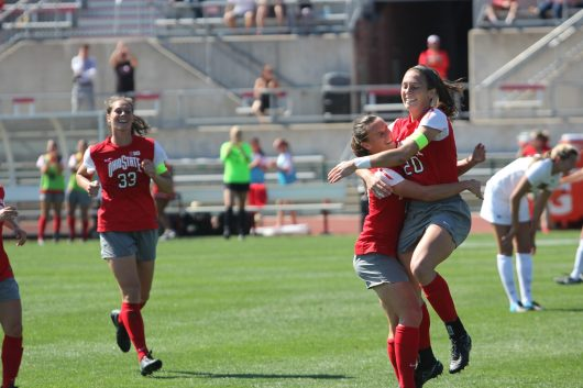 Ohio State senior forward Lindsey Agnew (20) celebrates one of her three goals against Iowa with Ohio State junior forward Sammy Edwards (19) in a game at Jesse Owens Memorial Stadium on Sept. 25, 2016. The Buckeyes won the game 3-0. Credit: Colin Hass-Hill | Assistant Sports Director