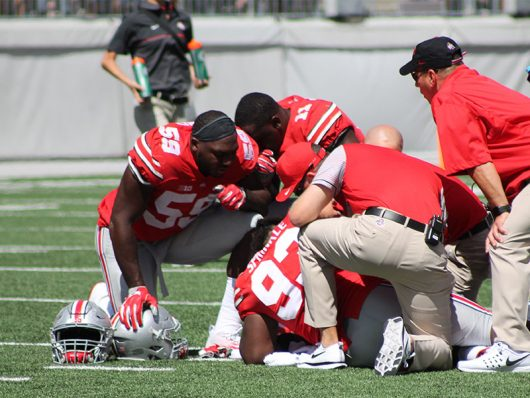 Tracy Sprinkle (93) lays on the field with a leg injury. He left the game following his injury during the first game of the 2016 season against Bowling Green on Sept. 3 in Ohio Stadium. The Buckeyes won 77-10. Credit: Mason Swires | Assistant Photo Editor