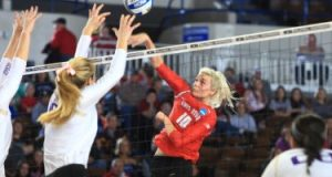 Senior middle blocker Taylor Sandbothe attacking at the net in a regional semifinal against the University of Washington on Dec. 11, 2015. Credit: OSU Athletics