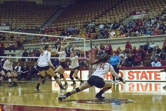 OSU freshman defensive specialist Camry Halm (14) dives for a ball during a game against Northwestern University on Sept. 28 at St. John Arena in Columbus, Ohio. OSU won 3-0. Credit: Ross Tamburro | Lantern Photographer